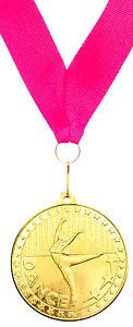 picture of a gold medal for a dance competition award hanging on a ribbon